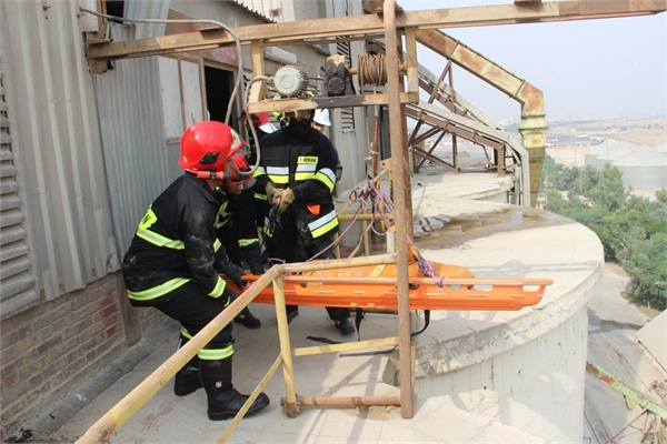 Firefighting maneuver and transfer of injured at Imam Khomeini Port